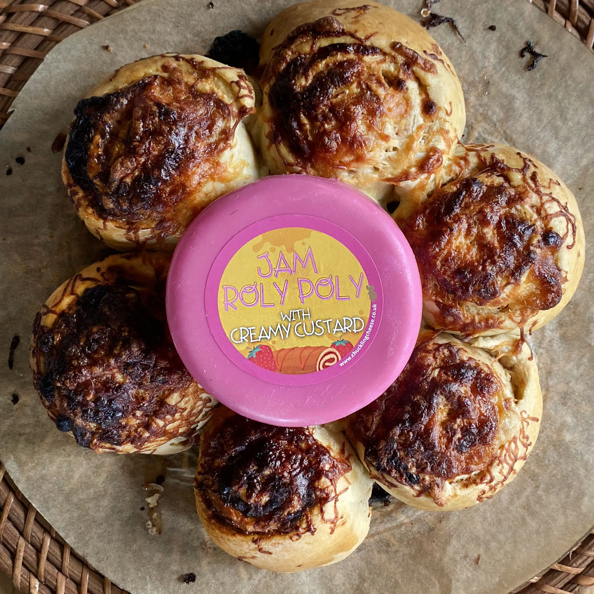 Golden brown Jam Roly Poly Swirls with a whole Jam Roly Poly Truckle in centre.