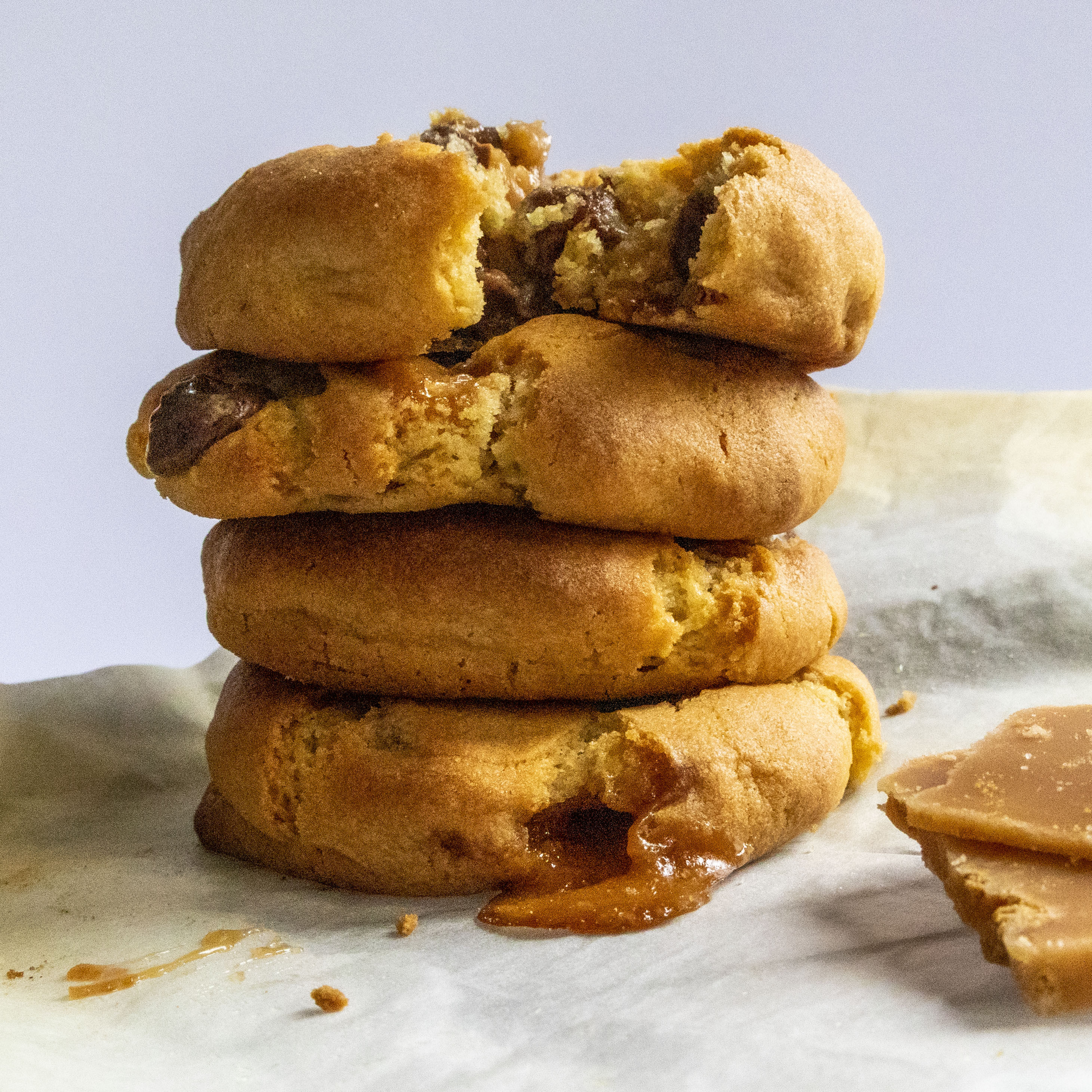 A stack of thick Biscoff fudge Chocolate Chip Cookies with small stack of Biscoff Fudge going out of the shot.