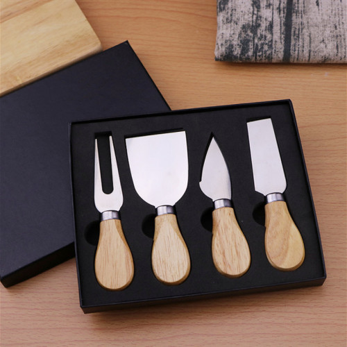 Four cheese knives in a gift box