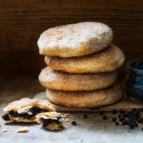 A stack of A Pack of Giant Eccles Cakes